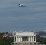 Discovery over Lincoln Memorial