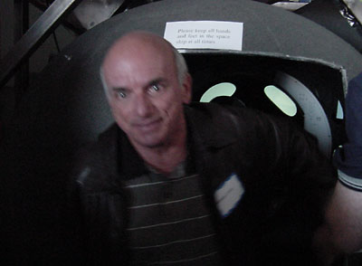 Dennis Tito emerges from simulator